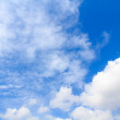 Distribution of white clouds on the clear blue sky for backgroun — Stock Photo #45405381