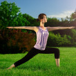 Yoga exercise (Virabhadrasana) — Stock Photo