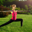 Yoga exercising (Virabhadrasana) — Stock Photo