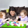 Mom is painting easter eggs with  childs. — Stock Photo