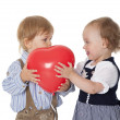 Royalty-Free Stock Photo: Little boy and girl playing  with balloon