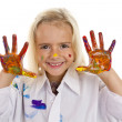 Little girl shows her colored hand  — Stock Photo
