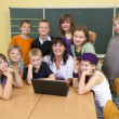 Teacher and children — Stock Photo