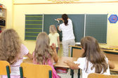 Teacher in a classroom — Stock Photo