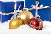 Christmas baubles on snow background — Stock Photo