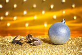 Christmas baubles on a gold background — Stock Photo