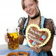 Bavarian girl  with beer, cake and pretzel. — Stock Photo