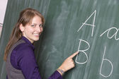 Young teacher at school — Stock Photo