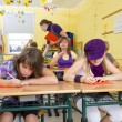 Children are doing a test in a yellow classroom at school. — Stock Photo