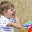 Little boy having fun with bubbles — Stock Photo