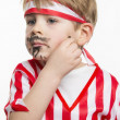Little boy drawing mustache — Stock Photo #39611319