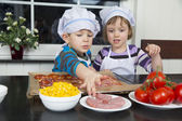 Children preparing pizza — Stock Photo