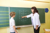 Boy near blackboard — Stock Photo