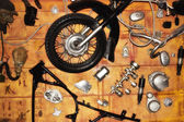The disassembled motorcycle on a wall — Stock Photo