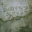 Skateboard sucks or 5K8B0ARD 5UCK5 - Stock Photo