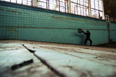 Man in abandoned swimming pool — Stock Photo