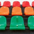 Multicolored stadium seats with numbering — Stock Photo #16419995
