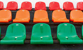 Multicolored stadium seats with numbering — Stock Photo