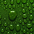 Green waterdrops — Stock Photo