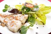 Fish fillet  with clam and herbs — Stockfoto