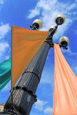 Street lamp with colorful flags — Stock Photo