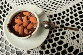 Hot chocolate with almonds — Stock Photo