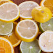 Lemon, Lime and Orange Slices on a Table — Stock Photo #18030959