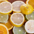 Lemon, Lime and Orange Slices on a Table — Stock Photo