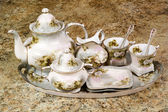 Floral tea set sitting on counter — Stock Photo
