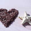 Stock Photo: Heart from seeds and starfish.