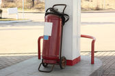 The fire extinguisher at gas station — Stock Photo