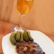 Liver in sauce and marinaded gherkins. — Stock Photo