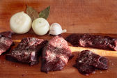 Beef liver, onions and leaf laurel. — Stock Photo