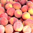 It is a lot of peaches. — Stock Photo