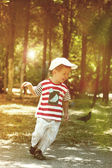 Little boy running in the park. — Stock Photo