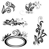 Set of floral silhouettes — Stock Vector