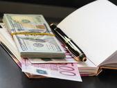 Paper money, notebook, handle. — Stock Photo