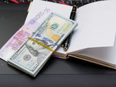 Paper money, notebook, handle. — Stock Photo
