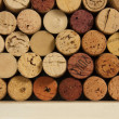 Wine corks on a shelf — Stock Photo