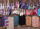 Handmade wool socks and sweaters — Stock Photo