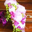 Wedding bouquet of pink peony flowers on antique dressing table  — Stock Photo