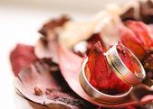 Two wedding ring on a potpourri background — Stock Photo