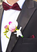 Close-up of Poeny pink flower on Groom's Tuxedo — Stock Photo