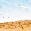 Stock Photo: Happy New Year 2014 replace 2013 concept on the sea beach
