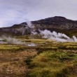 Stock Photo: Steam coming out of small geyser in geysir destrict in Iceland in autumn