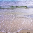 Euro word written in the sand on a beach, washed away by sea water — Stock Photo #33659041