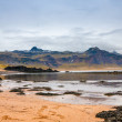 Sand beach with black voulcanic rocks in Iceland near Budir - small town on Snaefellsnes peninsula — Stock Photo #38258261