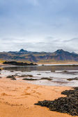 Sand beach with black voulcanic rocks in Iceland near Budir - small town on Snaefellsnes peninsula — Stockfoto