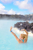 Beautiful young woman in Blue Lagoon geothermal spring , Iceland — Stock Photo