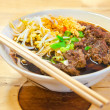 Close up of bowl of Chinese style beef noodle soup — Photo #38350253